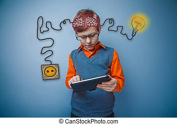 Teen boy with glasses working on a tablet with enthusiasm charging cord plug wire igniter charge and sketch infographics