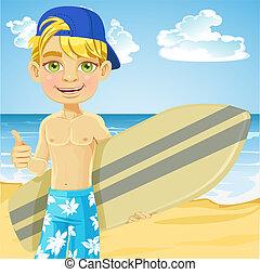 Teen boy with surfboard on a beach