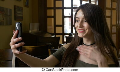 Teen broadcasting live session on social media from...