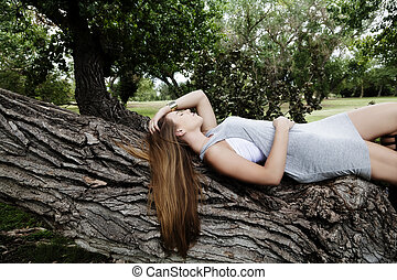 Teen Caucasian Woman Outdoor Reclining In Gray Dress