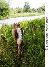 Teen Caucasian Woman Outdoor Standing In Tall Green Grass