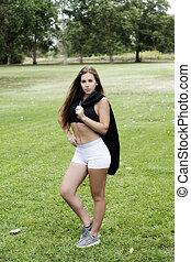 Teen Caucasian Woman Outdoor White Shorts Black Top