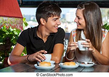 teen couple enjoying coffee together. - Close up of teen ...