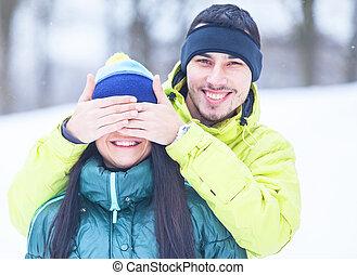 Teen couple in winter park.