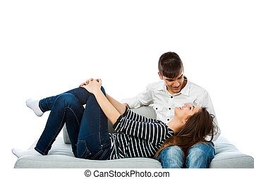 Teen couple relaxing on couch. - Portrait of teen couple ...