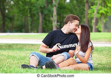 Teen couple with word Summer in the park.