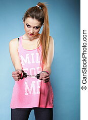 teen crime - teenager girl in handcuffs