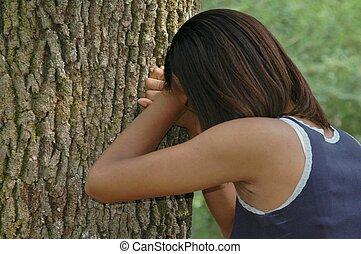 Teen Crying - Teen crying on a tree.