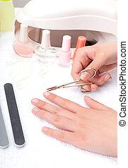 Teen cuts nails