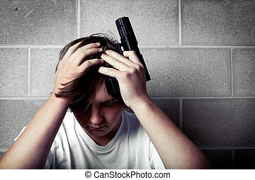 teen depression - teenager with hands on head holding...