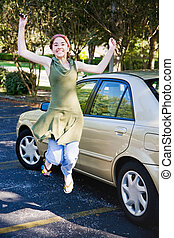 Teen Driver Jumping for Joy - Teen girl gets new car and...