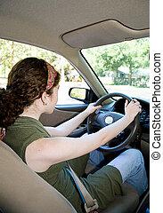 Teen Driver Vertical - Vertical view of a teen driver from ...
