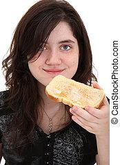 Teen Eating Toast