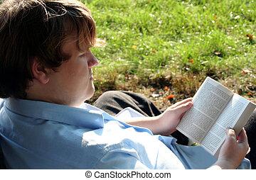 Teen Engrossed In Book Ou