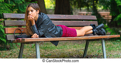 Teen face down on a bench