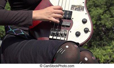 Teen Female Plucking Guitar Strings