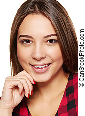 Teen female smiling with braces on her teeth - Closeup...