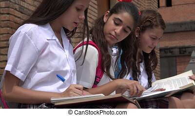 Teen Female Students Studying