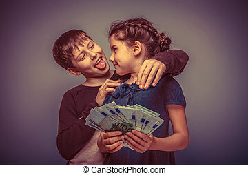 teen girl about seven years old holding a money boy teen hugging