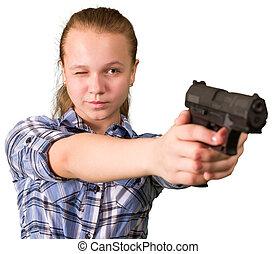 Teen girl aiming from the gun