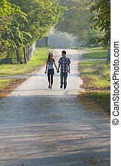 Teen girl and boy walking and looking each other