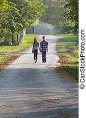 Teen girl and boy walking