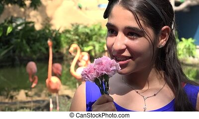 Teen Girl and Flowers in Nature