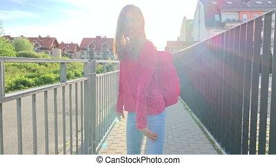 Teen girl back to school - Back view - schoolchild go to...