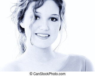 Beautiful Sixteen Year Old Teen Girl Portrait in Blue Tones. Great teeth and smile. Shot in studio over white.
