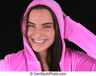 Beautiful Teen Girl In Pink Hooded Jacket over black. Shot with the Canon 20D.