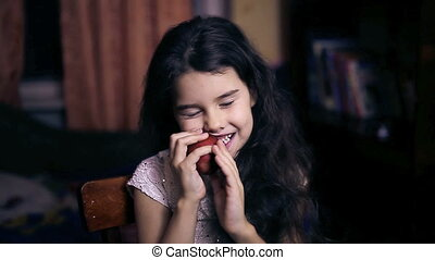 Teen girl child eating an apple bites a healthy diet for six...