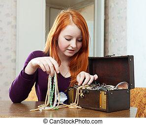 teen girl chooses jewelry