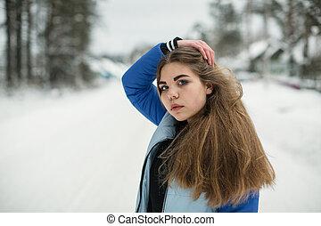 Teen girl closeup portrait outdoors in winter.