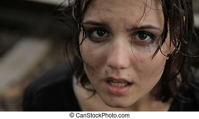 Teen girl crying in the rain
