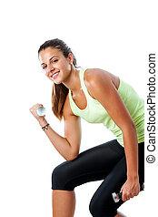 Teen girl doing bicep exercise.
