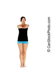 Teen girl doing exercise.