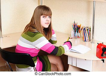 teen girl doing homework