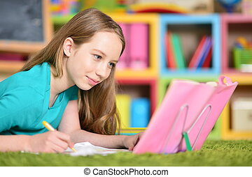 teen girl doing homework