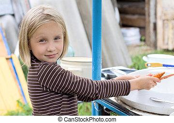 Teen girl doing housework