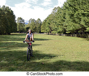Teen Girl Doing Tricks on Bicycle