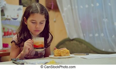 teen girl drinking tea and eating cake, indoor lifestyle...