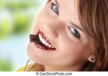 Teen girl eating chocolate