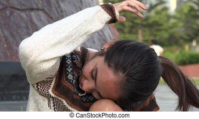 Teen Girl Fixing Hair