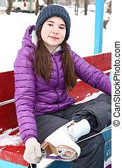 teen girl hair put on ice skate boots
