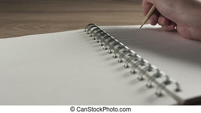 teen girl hand writes gift list on notepad, close up 4k ...