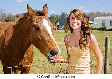 Teen Girl & Her Horse - Beautiful teen girl on the farm with...