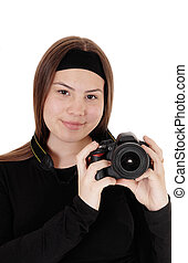 Teen girl holding a camera and taking pictures