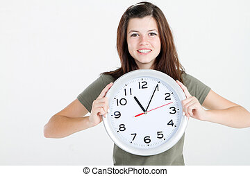 teen girl holding a clock - beautiful teen girl holding big...