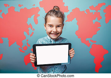 teen girl holding a tablet in the background world map photo...
