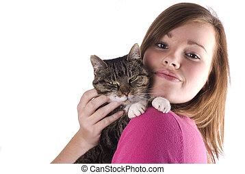 Teen girl holding cat.